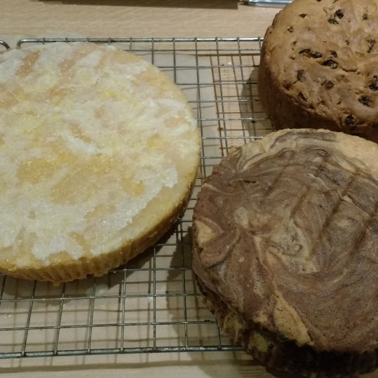 Double lemon drizzle, fruit cake and chocolate and vanilla marble cake