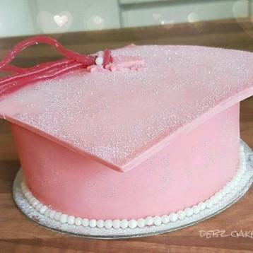 Pink sparkle graduation cap cake